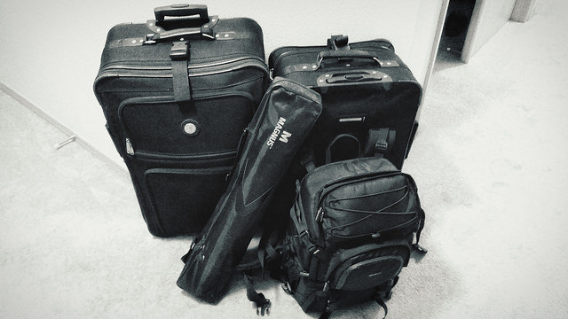 Four (4) pieces of luggage.